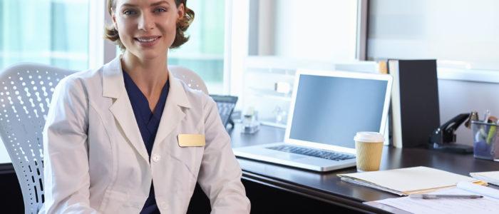 71352956 - portrait of female doctor wearing white coat in office